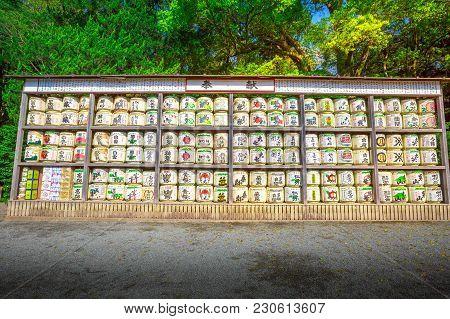 Kamakura, Japan - April 23, 2017: A Lot Of Japanese Sake Rice Wine Barrels With Decorative Writing I