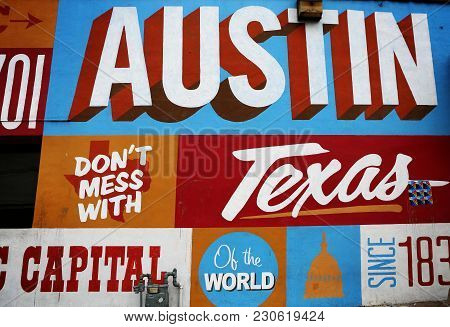 Austin, Texas - Mar 11, 2018: Wall At Famous 6th Street Painted With Texas Symbols. Popular Tourist