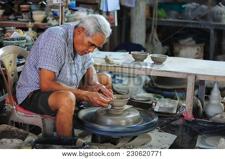 Sukhothai, Thailand - June 4, 2011: Senior Craftsman Making Pottery From Clay By Using Electrical Mo