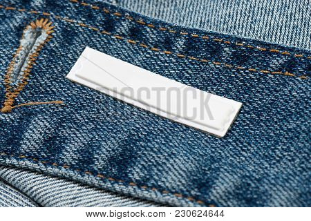 Security Tag on Blue Jean