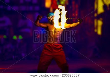 Nakhon Sawan, Thailand - Feb 19, 2018: An Entertainer Dances With Spinning Fire Wheel. This Is One O