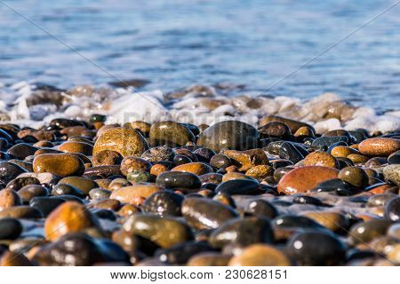 Stones At The Shoreline Which Cover The Beach At South Carlsbad State Beach In San Diego, California