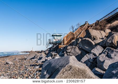 Boulders, A Lifeguard Tower, And A Staircase For Beach Access At South Carlsbad State Beach In San D
