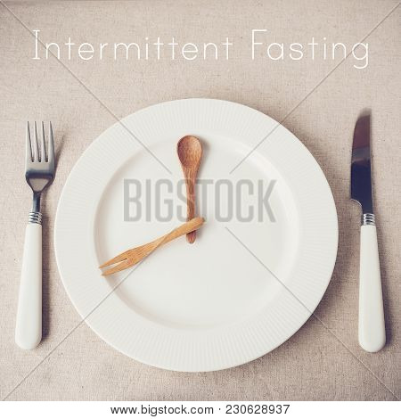 White Plate With Knife And Fork, Intermittent Fasting Concept, Ketogenic Diet, Weight Loss