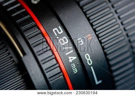 Macro Shot Of A Camera Lens Focusing On Camera Lens Information.