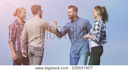 friends greet each other with a handshake