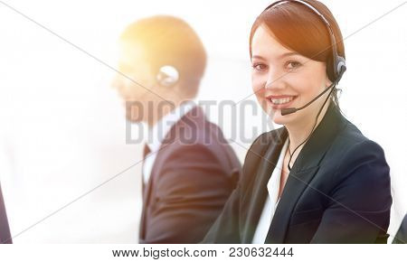 Female Customer Services Agent With Headset Working In A Call Ce