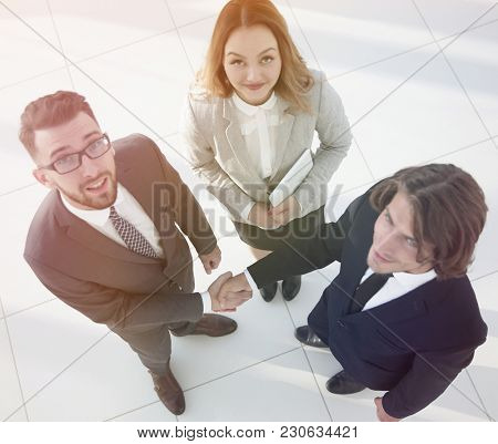 Business people shaking hands after good deal