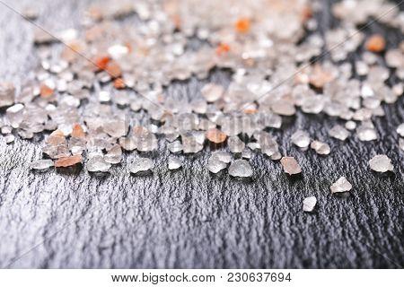 crystals of coarse grained salt on black background - detail
