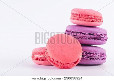 Set Of Pink And Purple Biscuit Macaroni Isolated On White