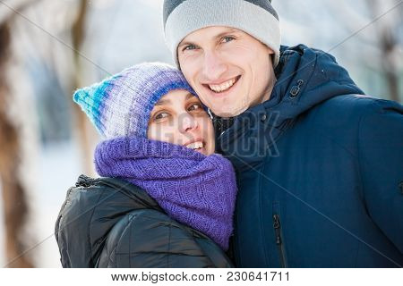 A Couple Is Walking Around The City.