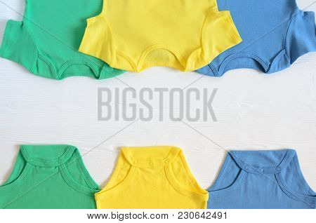 Babies Fashion Clothing (bodysuints). Shopping Concept. Flat Lay. Trendy, Saturated Colors. Wish Lis