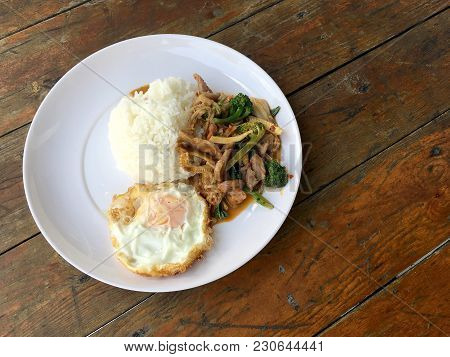 Asian Style Stir-fry Meat Slices With Fresh Vegetable With Rice And Fried Eggs In Thai Style Placed