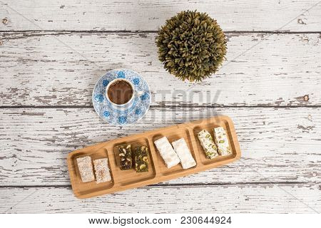 Traditional Turkish Coffee And Turkish Delight On Whitewooden Background.