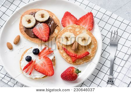 Colorful Breakfast Meal For Kids. Pancake Food Art, Funny Animal Faces Made With Fruits, Nuts And Ch