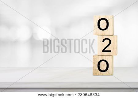 Online To Offline, O2o, On Wooden Cube Over Blur Background With Copy Space, Marketing Business Conc