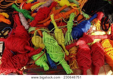 Hanks and coils of multi-colored threads and ropes poster