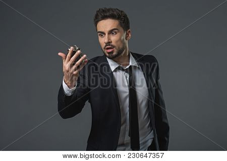Waist Up Portrait Of Shocked Businessman. He Watching At Snooze Time With Wide-eyed And Open Mouth I