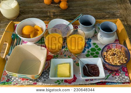 Breakfast Meal In A Tray On Wooden Table Outdoors. Al Fresco Eating