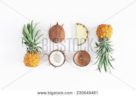 Fruit Background. Pineapples And Coconuts On White Background. Summer Fruits. Flat Lay, Top View