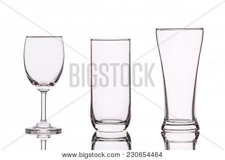 Different Of Empty Clear Drinking Glass. Studio Shot Isolated On White