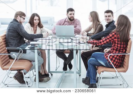 Successful Business Team Holding A Working Session At The Working Place In Office