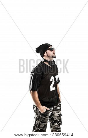 Charismatic Dj - Rapper With Headphones On A Light Background.the Photo Has A Empty Space For Your T