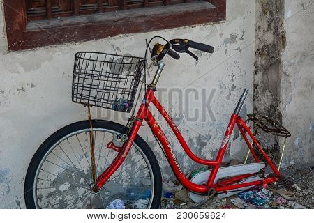 George Town, Malaysia - Mar 10, 2016. Old Red Bicycle In George Town, Malaysia. George Town Is One O