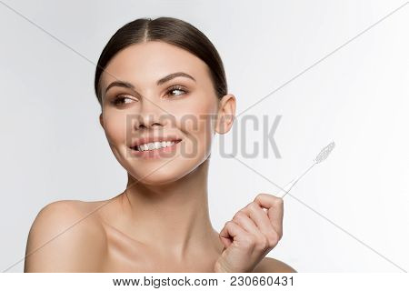 Portrait Of Joyful Girl Caring Of Her Oral Cavity. She Is Holding Brush And Smiling. Isolated