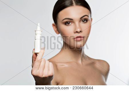 This Nasal Drops Will Cure You. Confident Young Lady Is Showing White Small Bottle Of Medicine. Focu
