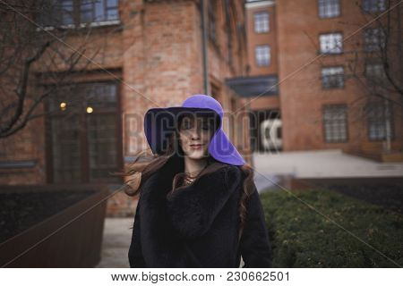 Beautiful Charming Young Woman With Closed Eyes And Long Luxurious Brown Hair In A Ultraviolet Color