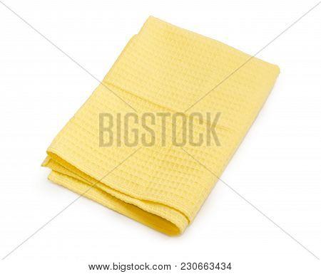 Folded Yellow Waffle Towel On A White Background