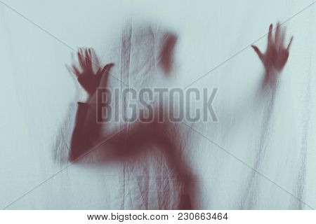 Scary Blurry Silhouette Of Person Touching Veil With Hands