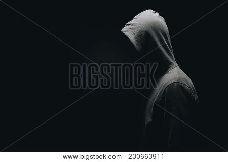 Side View Of Unrecognizable Man In Man Standing Isolated On Black