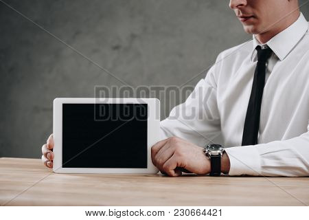 Partial View Of Businessman Holding Digital Tablet With Black Screen
