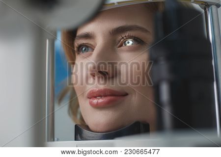Close Up Beaming Woman Face Inspecting Eyes In Ophthalmological Center. Medicine Concept