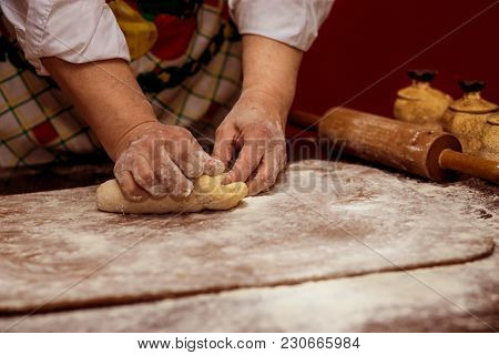 Female Hands Making Dough For Pizza. Making Bread. Cooking Process Concept