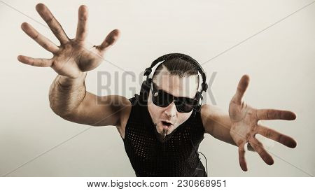 View From The Top - Dj - Rapper In A Stylish T-shirt With Headphones And With Hands Up On White Back