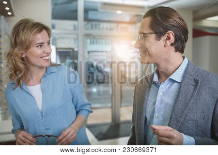 Outgoing Man And Female Looking At Each Other In Optical Store. Eyesight Correction Concept