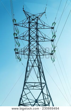 High Voltage Power Line Tower On A Blue Sky Background