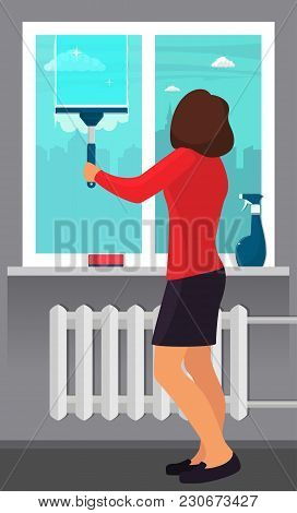 Woman Washing The Window With A Scraper. Window Cleaning. Scraper Glides Over The Glass, Making It C