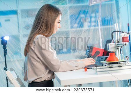A young woman design a model of an artificial organ on a 3D printer