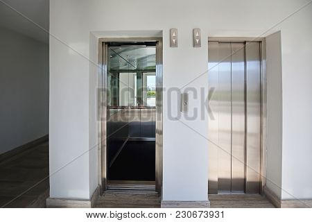 Open And Closed Lift Door At Modern Elevator