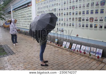 Kiev, Ukraine - May 28, 2016: Citizens At The Memorial Wall With Portraits Of Soldiers Killed In The