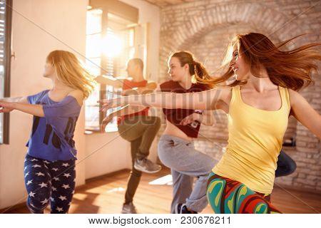 Young dancers dancing together in dancing studio