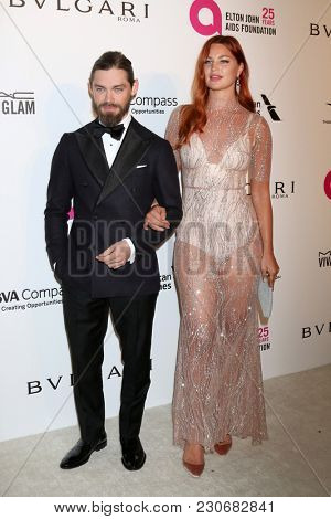 LOS ANGELES - MAR 4:  Tom Payne, Jennifer Akerman at the 2018 Elton John AIDS Foundation Oscar Viewing Party at the West Hollywood Park on March 4, 2018 in West Hollywood, CA