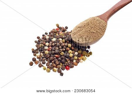 Top View Of A Wooden Spoon Full Of Grind Black Pepper Powder Surrounded With Black, White, Yellow An