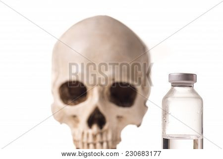 Medical Vials With Clear Liquid And Blurry Skull Isolated On White Background