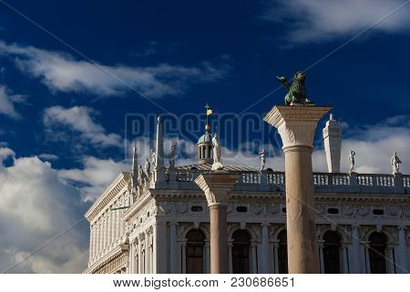 Saint Mark Square With Winged Lion Ancient Column And Old Renaissance Library At Sunset