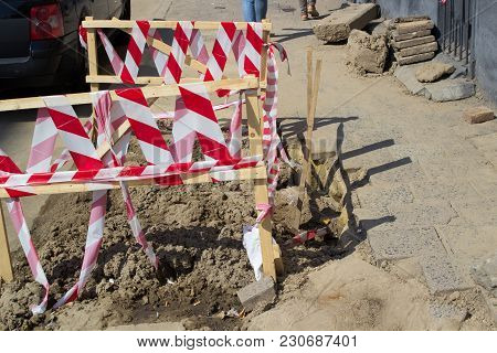 Barrier Around Sidewalk Pit, Fencing With A Red Ribbon Pit For Repair